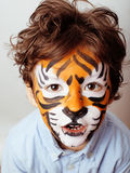 Little cute boy with faceart on birthday party Royalty Free Stock Photos