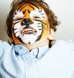 Little cute boy with faceart on birthday party close up, tiger stock photography