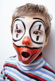 Little cute boy with facepaint like clown Stock Photo