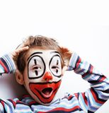 Little cute boy with facepaint like clown, pantomimic expressions close up stock image