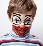 Little cute boy with facepaint like clown, pantomimic expressions close up Stock Photos