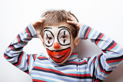 Little cute boy with facepaint like clown, pantomimic expressions close up Royalty Free Stock Images