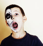 Little cute boy with facepaint like skeleton to celebrate hallow Stock Image