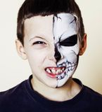 Little cute boy with facepaint like skeleton to celebrate hallow. Een, lifestyle people concept, children on holiday close up royalty free stock images