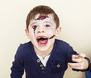 Little cute boy with facepaint like zombie apocalypse at hallowe. En party close up on white background Stock Image