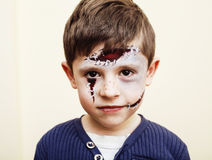 Little cute boy with facepaint like zombie apocalypse at hallowe. En party close up on white background Royalty Free Stock Image