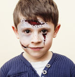 Little cute boy with facepaint like zombie apocalypse at hallowe. Little cute real boy with facepaint like zombie apocalypse at halloween party close up, treat Royalty Free Stock Photos