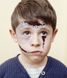 Little cute boy with facepaint like zombie apocalypse at halloween party close up, treat or treat people concept. Little cute real boy with facepaint like zombie Royalty Free Stock Images