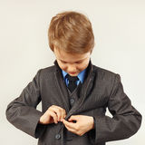 Little cute boy fastened business suit Stock Image