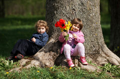 Little cute boy and girl on date Stock Images
