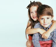 little cute boy and girl hugging playing on white background, happy smiling family, lifestyle people concept