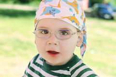 Little cute boy in glasses and striped t-shirt Stock Photos