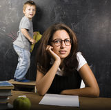 Little cute boy in glasses with young real teacher Royalty Free Stock Photo