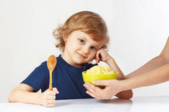 Little cute boy is going to have breakfast cereal stock photo