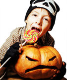 Little cute boy with halloween pumpkin close up holding candy, t Royalty Free Stock Photography