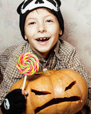 Little cute boy with halloween pumpkin close up holding candy, trick or treat smiling Royalty Free Stock Images