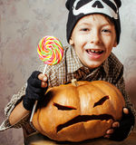 Little cute boy with halloween pumpkin close up holding candy, trick or treat smiling Stock Images