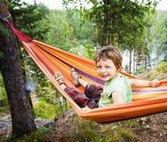 Little cute boy in hammock smiling Stock Photography