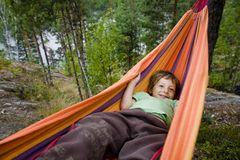 Little cute boy in hammock smiling Royalty Free Stock Photography