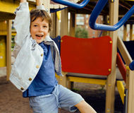 Little cute boy hanging on gymnastic ring Royalty Free Stock Photo