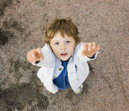 Little cute boy hanging on gymnastic ring Stock Photography