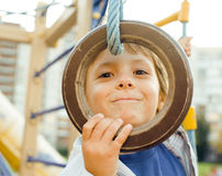 Little cute boy hanging on gymnastic ring Royalty Free Stock Photography