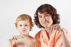 Little cute boy with his mother brush your teeth Royalty Free Stock Photos