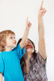 Little cute boy and his mother shows hand up Stock Photo