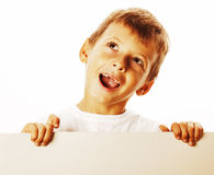 Little cute boy holding empty shit to copyspace isolated close u Royalty Free Stock Photos