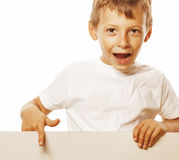 Little cute boy holding empty shit to copyspace Stock Images