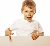 Little cute boy holding empty shit to copyspace Stock Photography