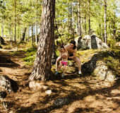 Little cute boy jumping with bungee in forest, training with dad Royalty Free Stock Images