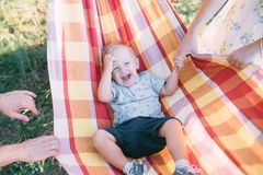 Little cute boy lies in a hammock and has fun royalty free stock image