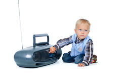 Little cute boy listens to the music Stock Photo