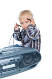 Little cute boy listens to the music Stock Images