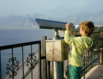 Little cute boy looking through telescope Stock Photography