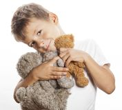 Little cute boy with many teddy bears hugging Stock Images