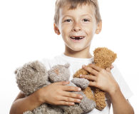 Little cute boy with many teddy bears hugging Royalty Free Stock Photography
