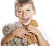 Little cute boy with many teddy bears hugging Stock Image
