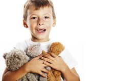 Little cute boy with many teddy bears hugging isolated close up Royalty Free Stock Images