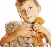 Little cute boy with many teddy bears hugging isolated close up Stock Photo