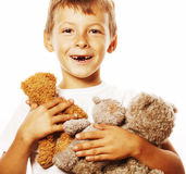 Little cute boy with many teddy bears hugging isolated close up Stock Image