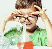 Little cute boy with medicine glass isolated wearing glasses smi Stock Images