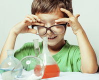 Little cute boy with medicine glass isolated wearing glasses smiling close up genius kid Royalty Free Stock Photos