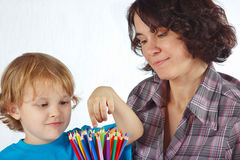 Little cute boy with mother with color pencils Stock Image