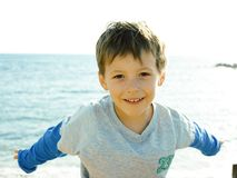 Free Little Cute Boy On Sea Coast Thumbs Up Playing With Rocks Royalty Free Stock Photos - 160294668