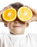 Little cute boy with orange fruit double isolated Stock Photos