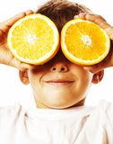 Little cute boy with orange fruit double isolated on white smili Stock Photography