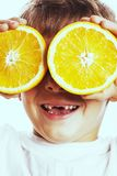 Little cute boy with orange fruit double isolated on white smili Royalty Free Stock Images
