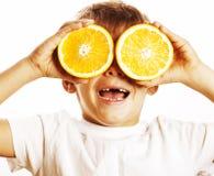 Little cute boy with orange fruit double isolated on white smili Royalty Free Stock Photo
